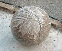 Spherical granite bollard with sandblast carving