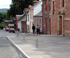 Reclaimed granite gate posts used as pavement bollards