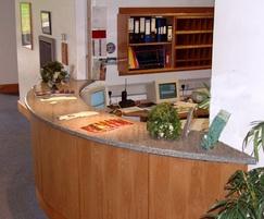 Curved granite worktop on reception desk