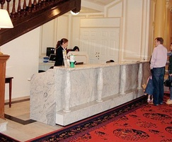 Ivory white granite hotel reception desk with pillars
