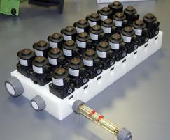 Multi-port valve block & ?owmeter for detergent dosing