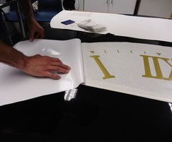 Numbers being fitted to the clock