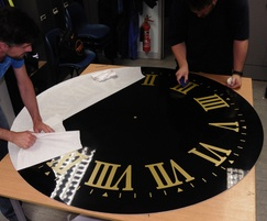 Gold Roman numerals on black clock face