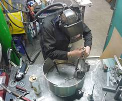 Stainless steel drum being manufactured