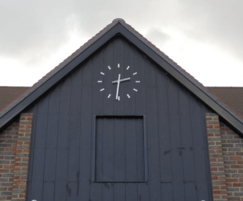 Modern, stylish clock above entrance door