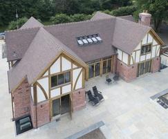 Canterbury handmade clay tiles suit oak timber frame