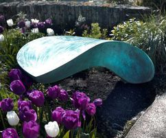 Logan Bench appears to float above the tulips