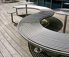 Centerline contemporary curved steel benches and tables