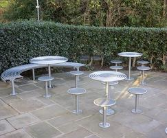 Stainless steel tables and stools, street furniture