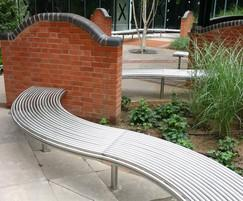 Curved stainless steel bench