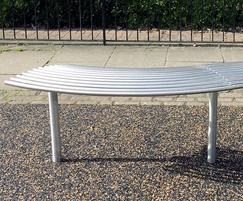 Curved bench from benchmark street furniture BL007