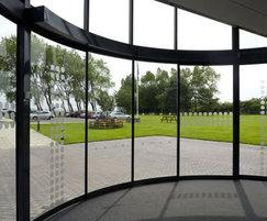 Sliding automatic curved doors