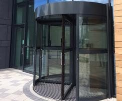 TORMAX revolving entrance & automatic swing pass door