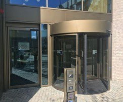 Automatic revolving door with swing pass door - TORMAX
