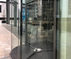 Glass revolving entrance by TORMAX