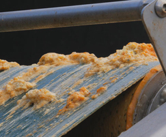 Greasebuster fats, oils and grease going over conveyor