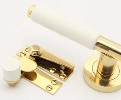 Arbor fittings painted white with brass components