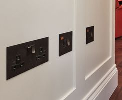 Power sockets with metal switches in antique bronze