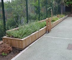 Long Barrier planters with top seating.