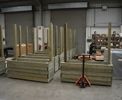 Mews planter with screens being manufactured