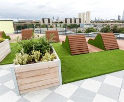 Slatted loungers and Mews planters for rooftop garden