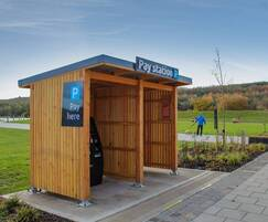 Bespoke pay station shelter clad in Scottish larch