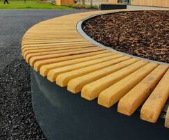 Inspira oval planter bench clad in Scottish larch