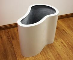 A planter finished in polished brilliant white