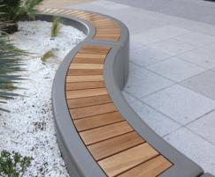 Iroko slats bench seating in island planter