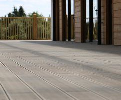 Composite decking boards have a reversible profile