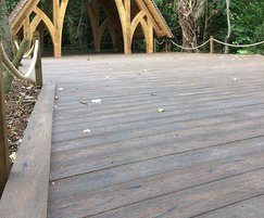 The decking has a natural, weathered wood appearance