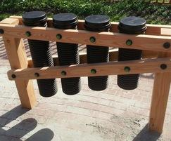 Pipe drums  set within square timber frame