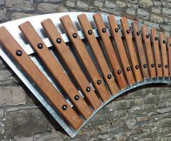Wall mounted hardwood xylophone on steel backplate