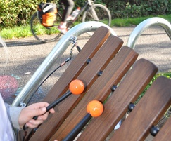 Steel frame xylophone with attached beaters