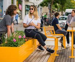 Parklets extend over parking spaces