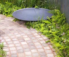 Pot Company: Steel Water Bowl features in Gold Winning Garden