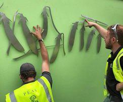 Bespoke pea metalwork being secured in place