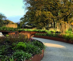 Bespoke corten steel edging for raised garden