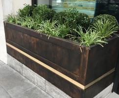 Bespoke bronze planter with contrasting brass strips