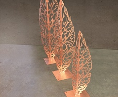 Laser-cut copper leaf garden sculptures