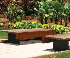 A bench made of wood and cast iron
