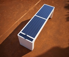 Black photovoltaic panels on solar-powered bench