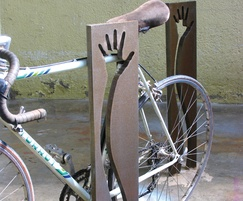 Serves both as a boundary marker and a bike rack