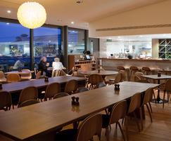 Large fumed oak sharing tables for restaurant