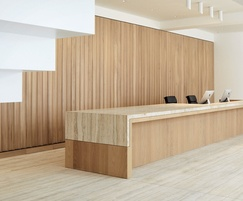 Bespoke marble & timber reception desk; oak panel wall