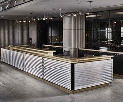 Bespoke brass topped reception desk