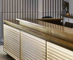 Brass topped reception desk with LED lighting