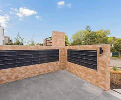 Estatewall™ stone cladded wall with letterboxes