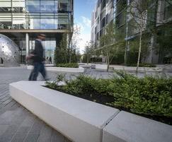 Bespoke white exposed concrete planter walls & benching