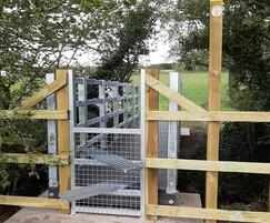 Steel stile kit installed at end of a Bison Bridge